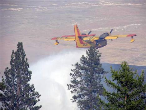 A CL 215 scoop plane from Minnesota drops water on the West Garcon fire last week.