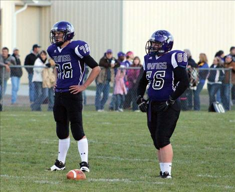 Charlo High athletes Trinceton Brown and Hunter McGee wait for the Arlee offense to line up at the line of scrimmage.