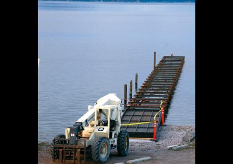 Work continues on the old city dock in Polson.
