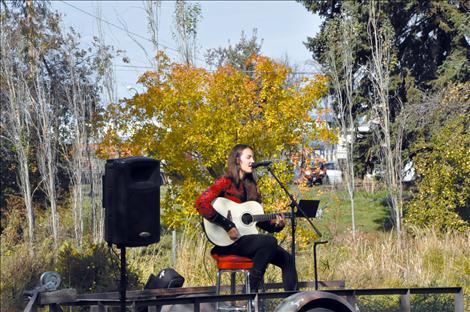 Halladay Quist performs at the Pig in the Park event.