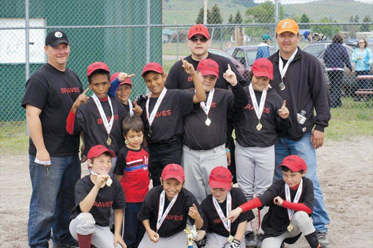 The Ronan Braves Little League baseball team celebrates after winning the Mission Valley Minors Tournament June 1-3 in Arlee. Back row, left to right, are coaches John Dolence, William Croft, and Doug Mays. Middle row, left to right, are Girma Detwiller, James Bennett, Darian Williams, Hunter Jore and Justin Mays. Front row, left to right, are Eric Dolence, Ariam Croft, Sheadyn Croft, Dylan Davis and Caden Rhine.