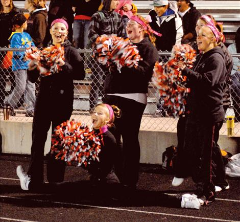 While working hard to cheer on their school's teams, Ronan cheerleaders face the possibility of having their program cut.