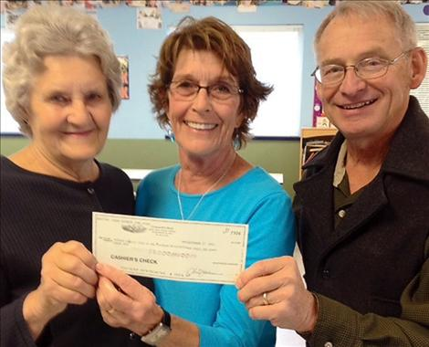 Kathy Gallagher and Alice Gleason present a $15,000 check to John Schnase, executive director of the Boys and Girls Club, so Club members can take swim lessons at Mission Valley Aquatic Center.