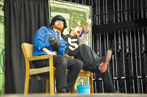 Daniel Prillman of the National Children's Theater plays a loan shark preying on a hapless teen, played by Sam McCalla, purchasing his first car. The duo performed the Mad About Money show to Ronan Middle School students.