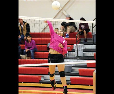 Scarlet Morgan Malatare goes up for the kill.