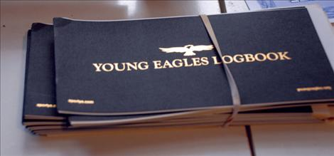 Each Young Eagle receives a logbook to keep track of flying hours.