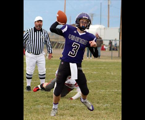 Sophomore quarterback Michael Delaney completed 9 of 12 passes for 121 yards and two touchdowns during the Vikings' playoff win Saturday against Twin Bridges.