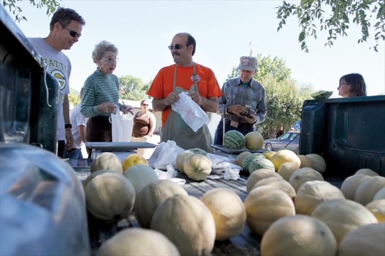 Buyers check out the goods at Melon Days.