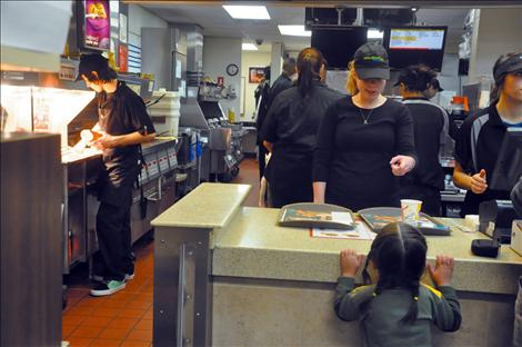 K. William Harvey teacher Whitney DuMont teases one of her students as she waits for food during a McDonald's fundraiser.