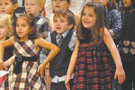 """Strange faces and body language accompanied a performance of """"Wacky Old St. Nicholas,"""" which Mrs. Lloyd's class provided instrumental accompainment in K.William Harvey's Christmas Carol-Along."""