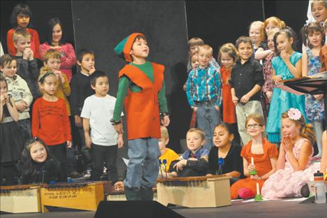 """Gabriel Brown plays Jingle, """"the Happy Bell"""" as Mrs. Lozar's class provides instrumentation in the K. William Harvey Elementary School's Christmas Carol-Along."""