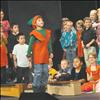 "Gabriel Brown plays Jingle, ""the Happy Bell"" as Mrs. Lozar's class provides instrumentation in the K. William Harvey Elementary School's Christmas Carol-Along."