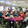 "The Kuilix chapter of the Daughters of the American Revolution hosted a Christmas party for the residents of the St. Luke's Assisted Living Center in Ronan on Saturday, Dec. 14. Festive  holiday music was played by the Mission Valley ""Ukulele Jam."" Refreshments were provided."