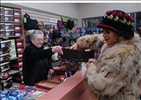 Merchants thank  shoppers with holiday  giveaway