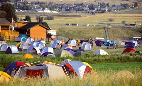 Firefighters sleep in a tent city at the Polson Fairgrounds.