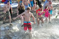 People brave icy waters in New Year's Polar Plunge