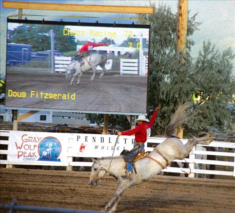 A jumbotron documents every move in the bronc riding contest at the Flathead River Rodeo last weekend in Polson.