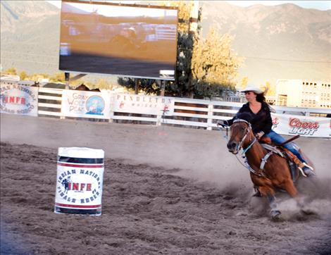 Sammy Jo Bird heads into the first barrel Saturday evening while the Jumbotron documents  every move.