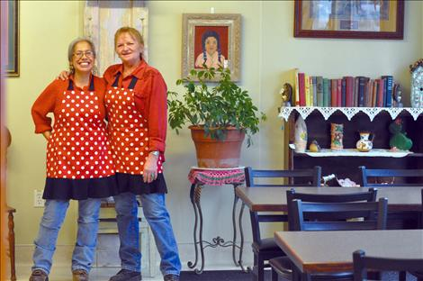 Ofelia Folsom, left, and Lisa Fredlund are constantly laughing as they cook and greet customers at La Cocina De Esperanza.