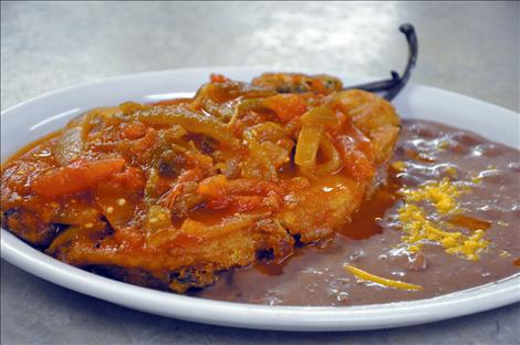 A Chile Relleno plate emerges from the Sonora Grill kitchen.