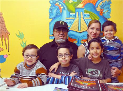 Rick and Elizabeth Moreno recently opened the Sonora Grill in Ronan. They took a moment to pose behind the hostess tables with their sons Enzo, Lucca, Venice and Gianni.