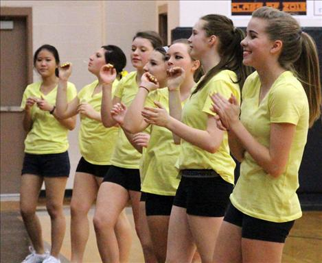 Ronan cheerleaders dressed in yellow t-shirts in support of Head Coach Shelly Buhr's neice, who is fighting cancer.