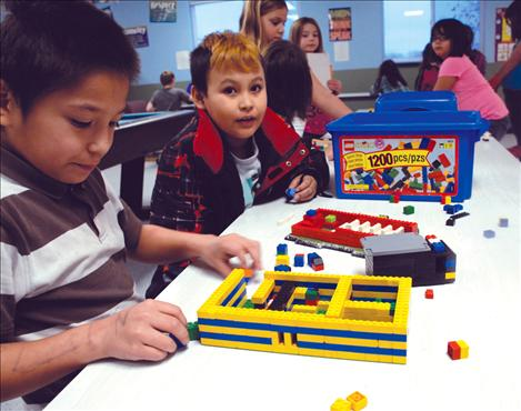 Thomas Redmond, left and Leighton Wise Spirit enjoy some after-school Lego time at the Boys and Girls Club in Ronan.