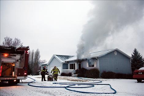 Smoke pours from a duplex on Hillcrest Drive in Polson on the morning of Jan. 23.