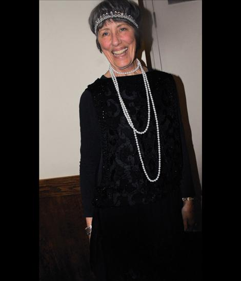 Flapper Valerie Lindstrom sports a vintage dress for the Tribute to the Great Gatsby party to open FLIC.