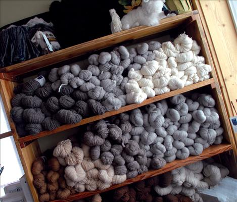 Skeins of smooth alpaca fiber await sale.