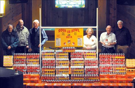 Merle Parise, Bryan River, Bill Smith, Sherri McDonald, Dale Jackson and Russ Jenkins stand with 4,004 units of soup that will be given to the Polson Loaves and Fish and Ronan Bread Basket food pantries.