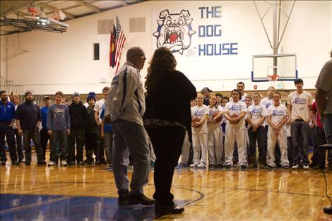 At the girls' basketball game, Les Rice fans — those he has coached or coached alongside — gathered on the gym floor to celebrate his 34 years of coaching, with the support of wife Lou Rice.