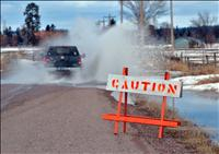 Nowhere to run: Warming air, thawing snow, frozen ground creates flooding throughout county
