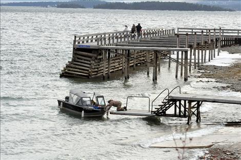 Jerry Benson launches his boat to fish for lake trout during Spring Mack Days on Flathead Lake.