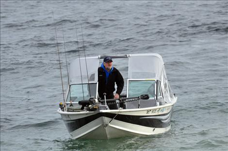 Scott Bombard fishes for lake trout during Spring Mack Days on Flathead Lake.