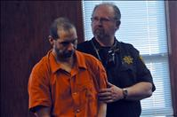 Arraignment delayed for hammer attacker