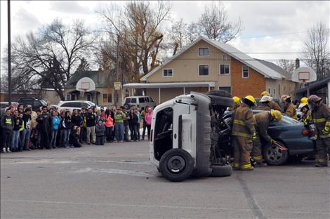 Students watch the drunken driving reenactment at Ronan High School.