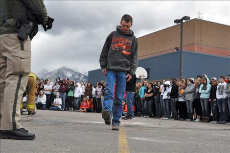 Ronan student Jesse Melton portrays a driver undergoing a field sobriety test during the reenactment.