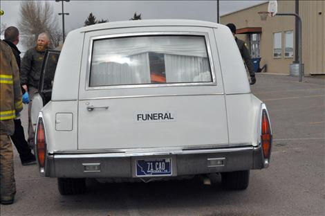 A hearse from a local funeral home was ready to cart off the deceased in the mock drunken driving reenactment.