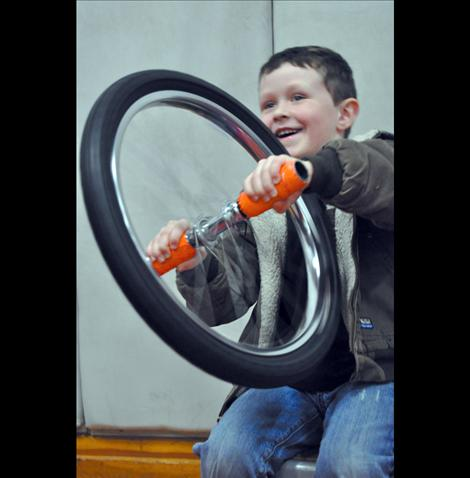 Haysen Hakes learns about physics using a bicycle wheel.