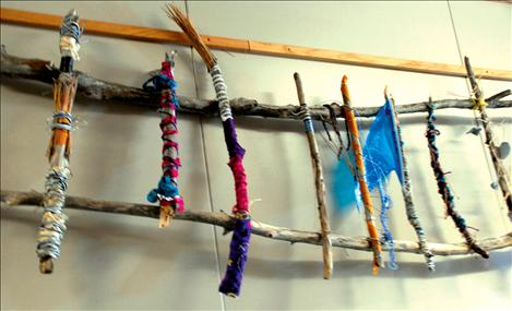 Talking sticks made by PHS art students wake up the wall near PHS Principal Rex Weltz's office