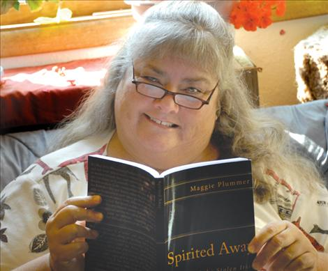 """Maggie Plummer reads a proof copy of her novel, """"Spirited Away."""" The book is set in the 1700s, mostly in Barbados, and the main character is Freddie O'Brennan. Plummer will be holding local book signings."""