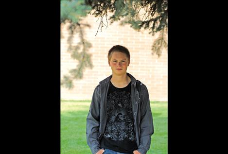 Cash Sisler stops on his way to cross-country practice Sept. 14. Sisler heard a page about a burning tree near Carmp Marshall and organized volunteers, according to Polson Assistant Fire Chief Pete Bishop.