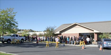 Customers line up at Eagle Bank in Polson on Wednesday, Sept. 12, when enrolled members of the Confederated Salish and Kootenai Tribes received $10,000 each as part of a settlement between the federal government and the tribes.