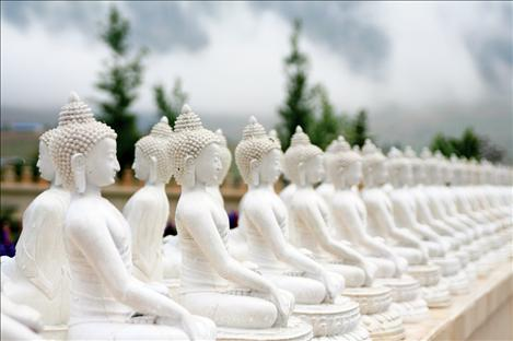 Stupa statues line the walkways at the Garden of One Thousand Buddhas.