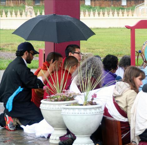 The Buddhists prayed for an hour last Friday morning, enduring the cold morning rain.