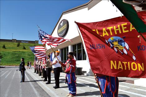 Murdoch's grand opening Thursday, June 5 was heralded with a ribbon cutting, flag raising, posting of colors by local honor guards and the Veteran Warrior Society, an honor song sung by drum group Chief Cliff, the National Anthem sung by veteran Charlene Crenshaw, and an angel's prayer and blessing offered by Salish tribal elder Francis Stanger.