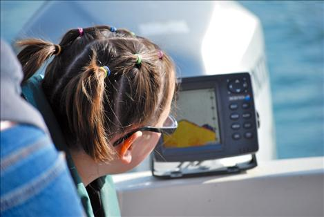 "Breanna Reinsberg watches a fish, aka ""the black blob,"" on the fish finder."