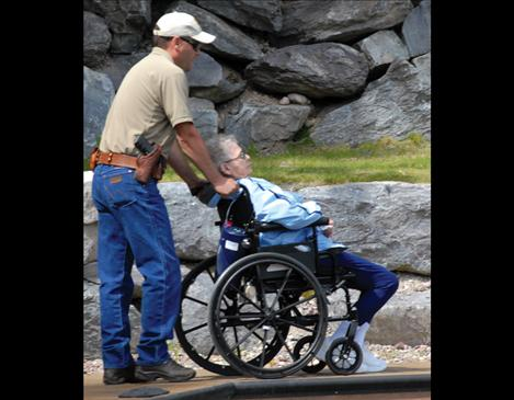 A game warden assists a participant.