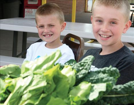 Tucker Brown, 9 and Tyler Brown, 11, sold donated turnips, beats, kale and carrots to help raise money for the Arlee Community Development Corporation.